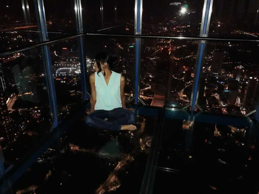 Girl sitting in skybox at KL Tower