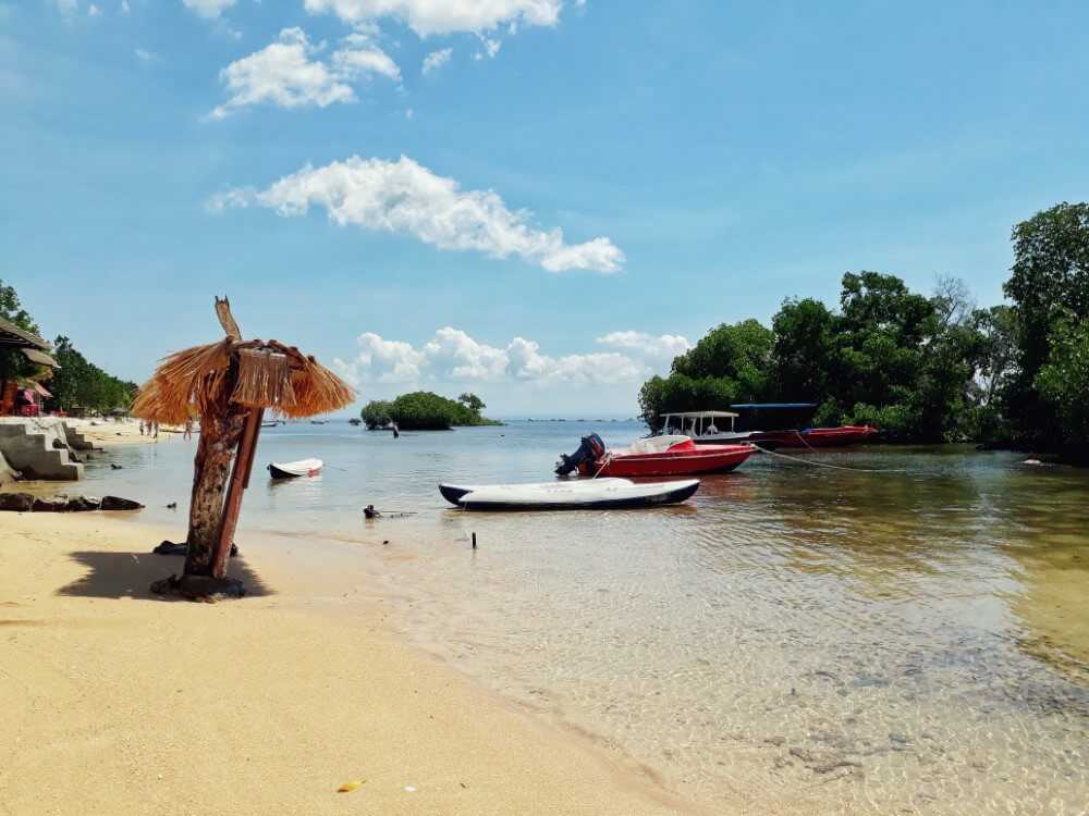 boats moored near the beach at Mangrove forest Nusa Lembongan