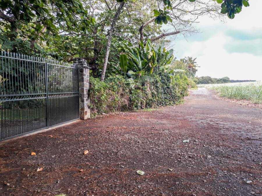 metal gate leading to Ilot Brocus in Mauritius