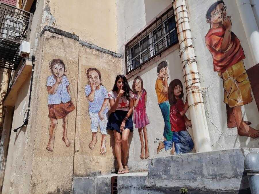 blending with the art on Mural Lane Ipoh Malaysia itinerary