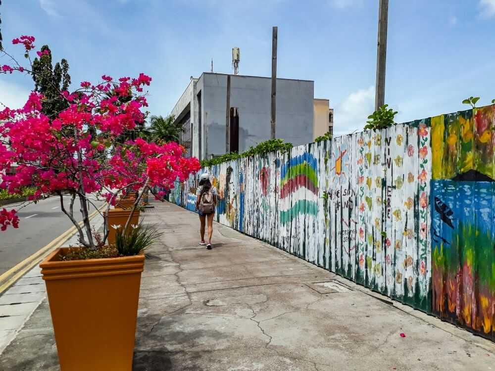 Girl strolling along the street arts in Seychelles