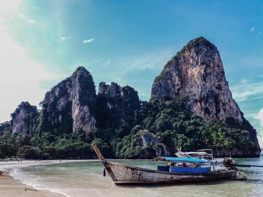 Boats moored on the shore of Railay West in Krabi
