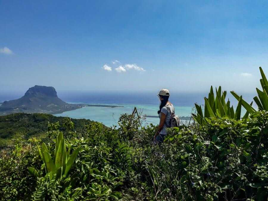 Girl looking over Le Morne Brabant at Ebony Forest in Mauritius