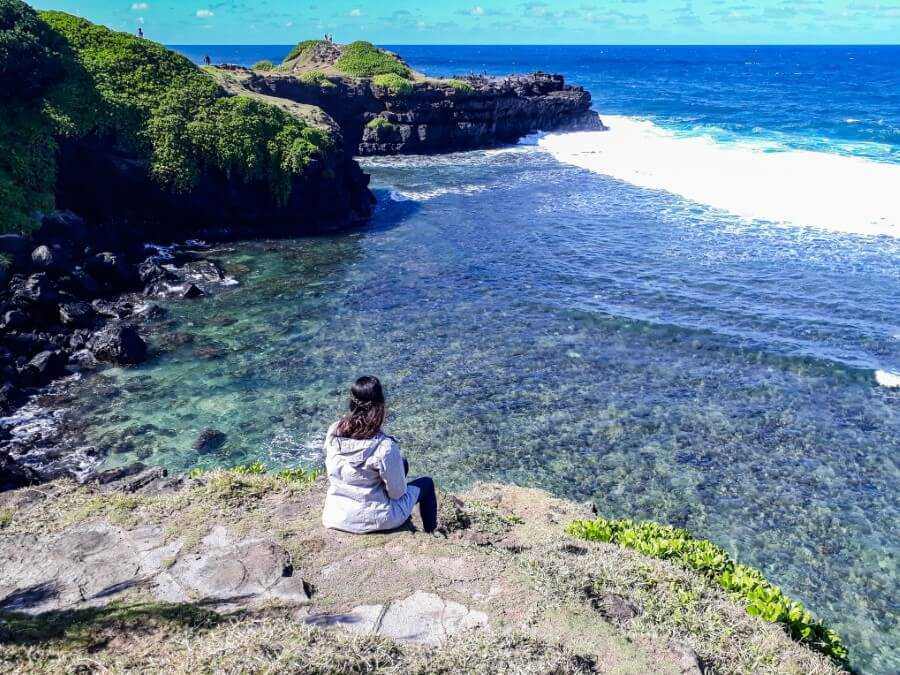 Girl enjoying the view at Gris Gris Beach in Mauritius