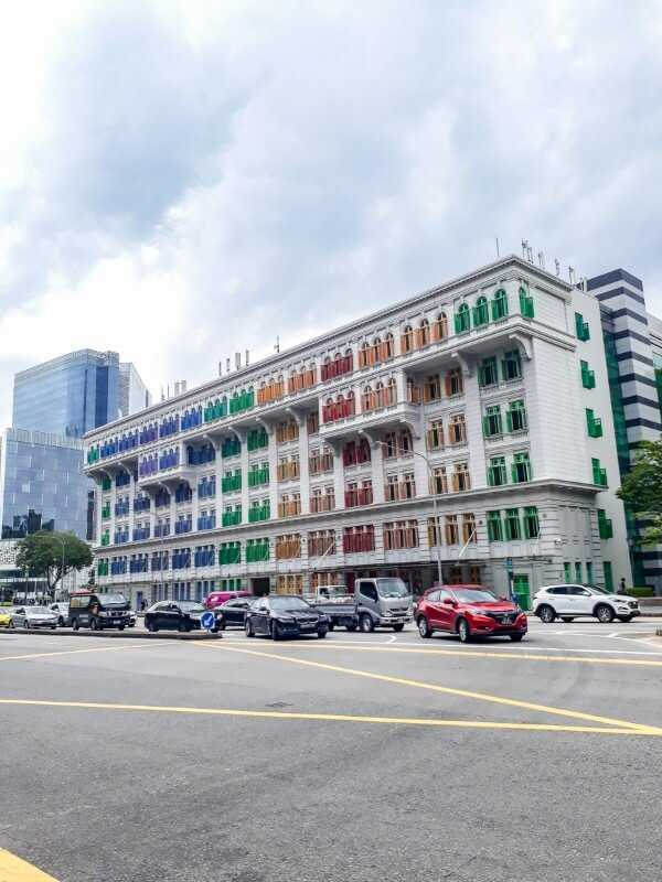Building with rainbow-colored windows on Hill Street in Singapore