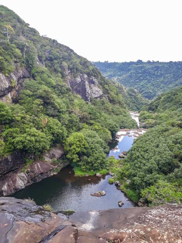 View of the valley and river from the top of Tamarind Falls in Mauritius