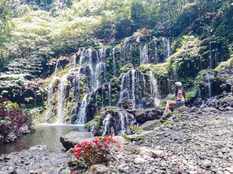Water cascading from the rock wall at Banyu Wana Amertha Waterfalls in Bali
