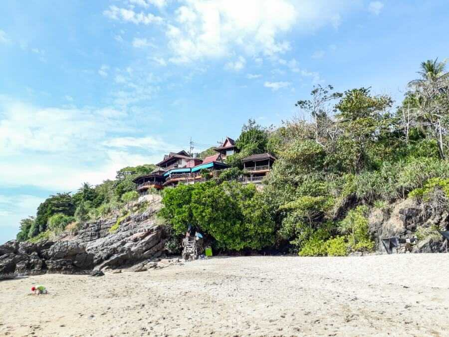 Wooden buildings sitting on top of the cliffs at Nui Beach