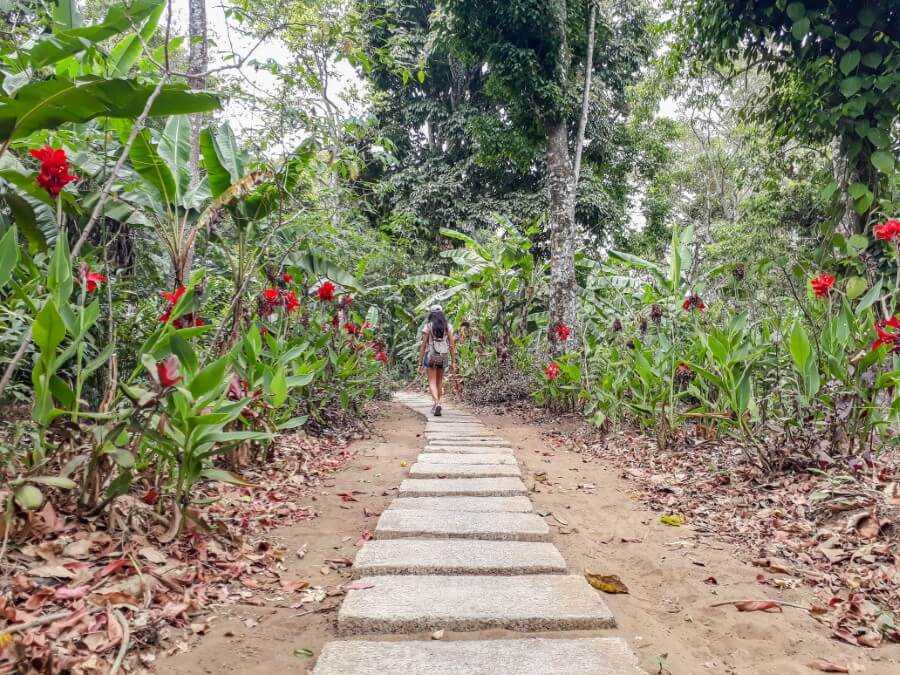 Girl walking along the path leading to Banyu Wana Amertha Waterfalls