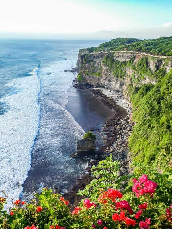 Cliffside views and flowers at Uluwatu Temple