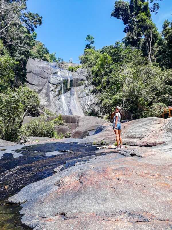 Girl posing in front of waterfall in Malaysia