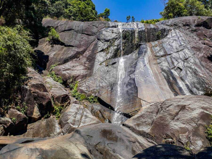 Water cascading over a huge rock wall in Malaysia
