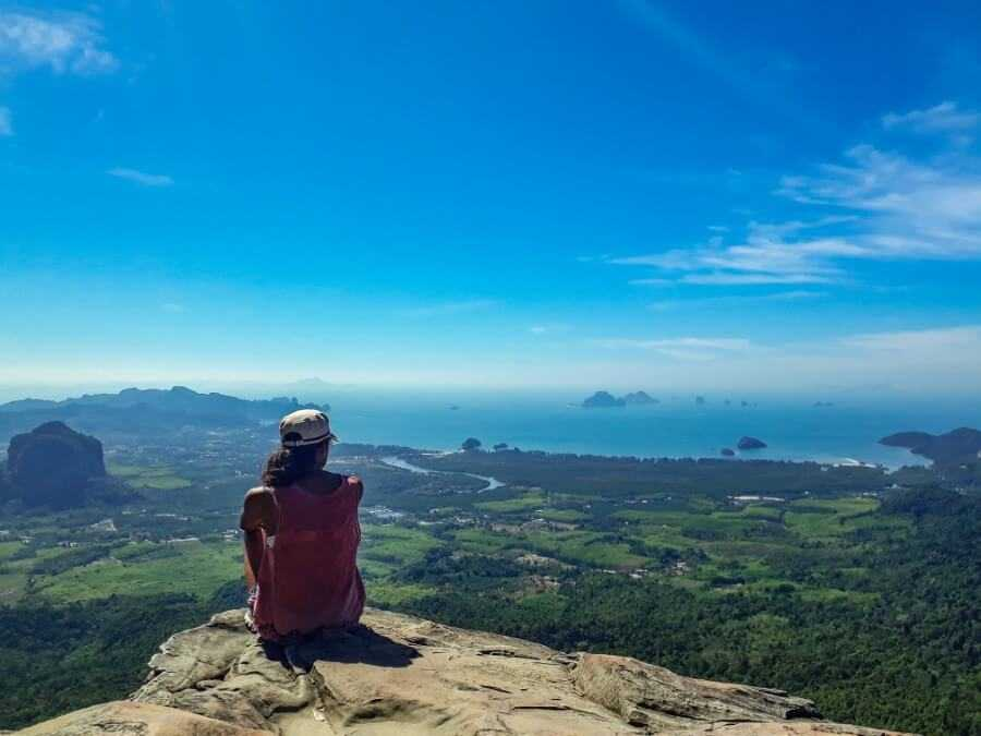 Girl sitting on top of mountain in Krabi