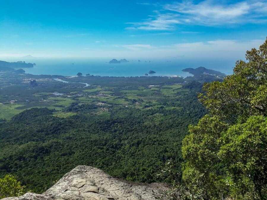 Limestone cliffs on land and sea at Tab Kak Hang Nak Hill Nature Trail in Krabi