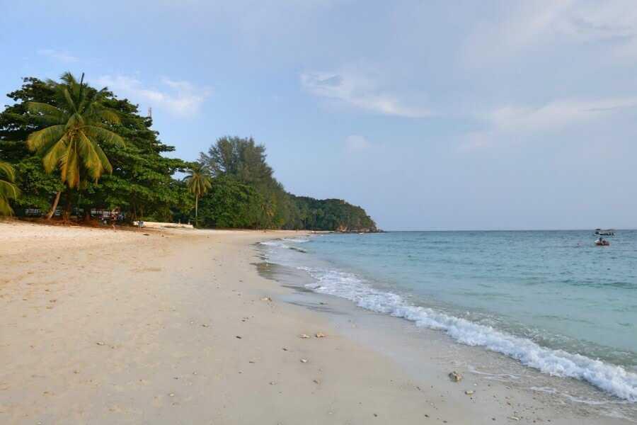 Palm-fringed beach on Kapas Island