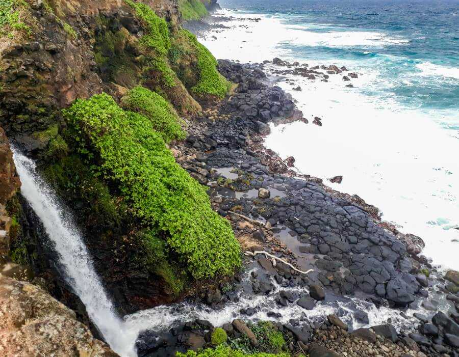 Waterfall flowing directly into the ocean