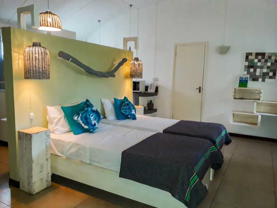 Bedroom and nightstand at Vanilla House Mauritius