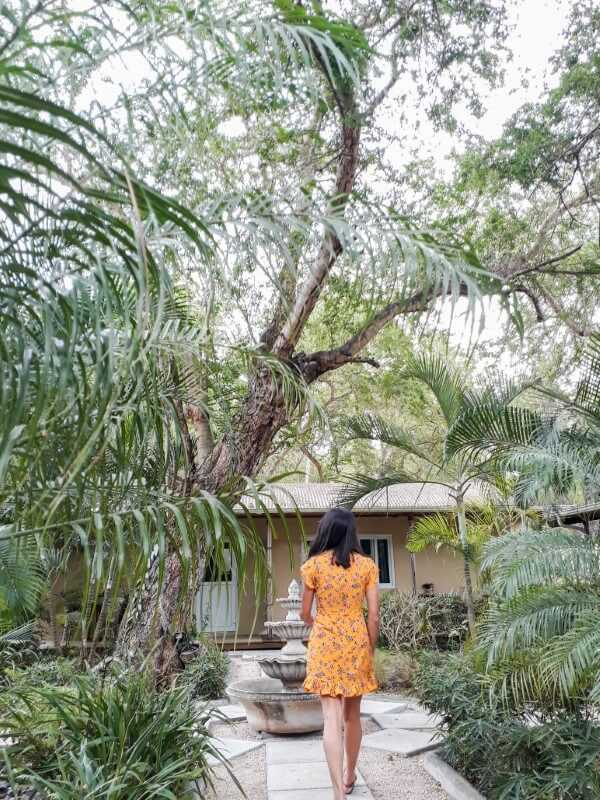 Girl strolling around a tropical garden at Vanilla House Mauritius