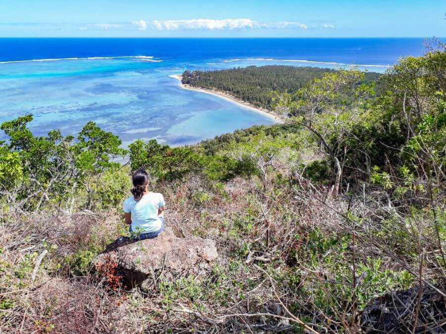 Girl enjoying the view of Le Morne Beach from Le Morne Brabant hiking trail