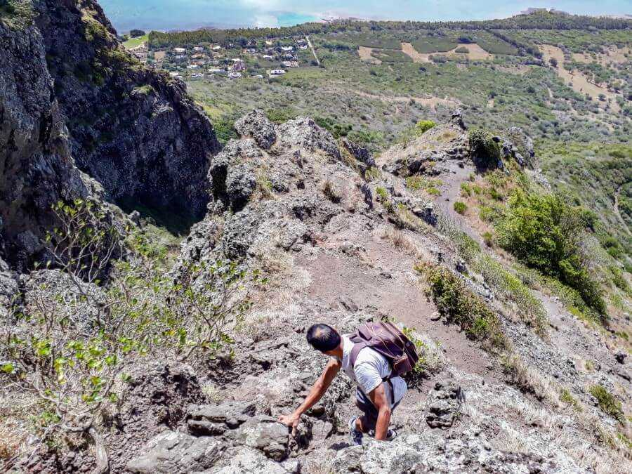 Man climbing down the mountain in Mauritius