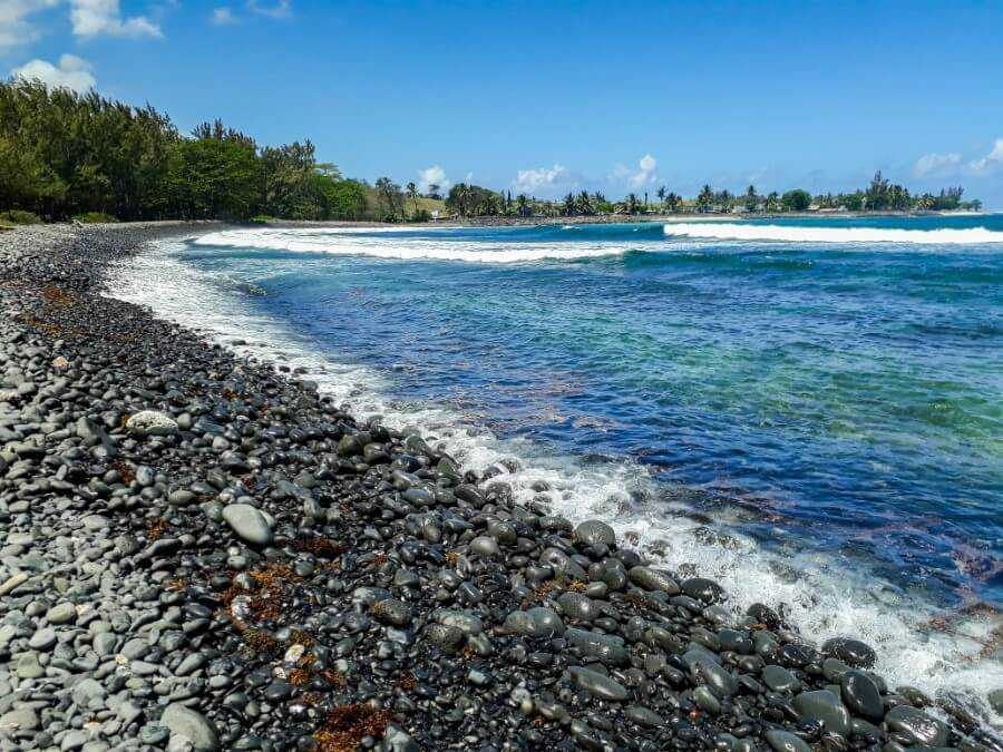 waves breaking on the shore of a pebble beach in Mauritius