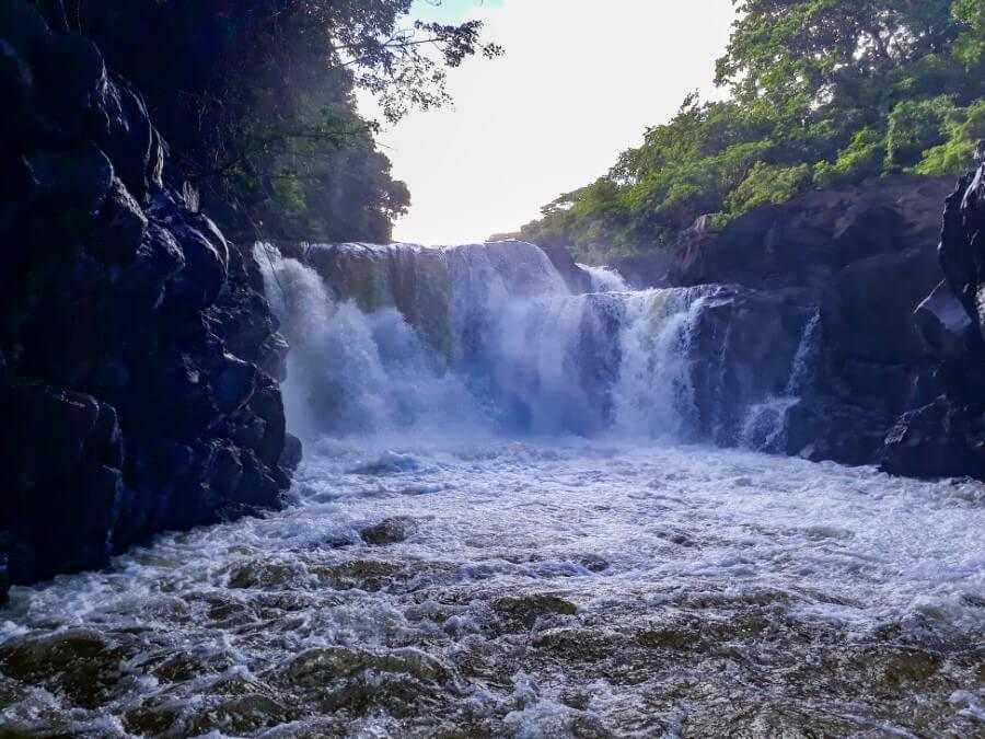 GRSE waterfall flowing into the ocean in Mauritius